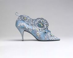 One of the most famous of Vivier's designs is an evening bottine from 1961. It was a confection of lace embellished with beads, sequins, couched silk ribbon and silver embroidery balanced on a thin needle heel of moderate height. Photo credit: Image copyright © The Metropolitan Museum of Art. Image source: Art Resource, NY (CNW Group/Bata Shoe Museum)