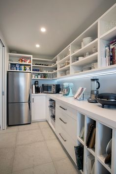 This scullery also houses a second fridge-freezer. It also has a combination of drawers, open shelves and wire drawers which is great to store items such as onions that need to breathe Kitchen Pantry Design, Prep Kitchen, Kitchen Decor, Kitchen Butlers Pantry, Kitchen Storage, Kitchen Cabinets, Pantry Laundry Room, Walk In Pantry, Scullery Ideas