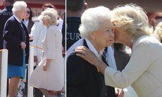 Camilla, Duchess of Cornwall, curtsies as she greets the Queen