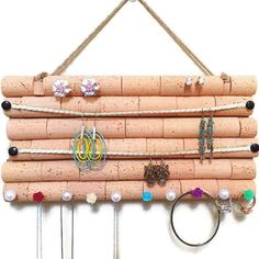Wine Cork Jewelry Organizer - a handmade jewelry hanger made out of wood and wine corks. Just stick the stud earrings into the cork - how clever! #diystudearringsunique #winebottlecrafts
