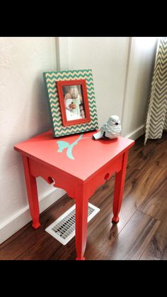 Coral and mint side table. Just bought it for the living room!