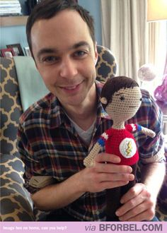Jim Parsons with a crochet doll of himself.