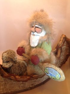 Hand Carved Wood Santa in a Canoe by TPOriginals on Etsy