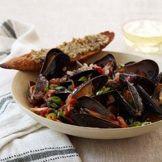 Healthy Mario Batali Recipe: Chile-Steamed Mussels with Green Olive Crostini Spicy Recipes, Wine Recipes, Cooking Recipes, Healthy Recipes, Shellfish Recipes, Seafood Recipes, Steamed Mussels, Mario Batali, Seafood Dishes