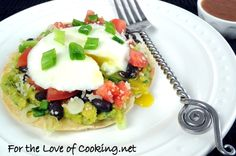 Breakfast Tostada with Guacamole, black beans and poached egg (I am thinking a fried egg)