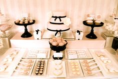 Dessert Table for a baby or bridal shower. Or maybe a ladies' tea. The black serving pieces make it pop!* how about a bowl of PINK eggs/ like the Black pedestals