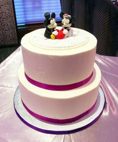 Lisa and Aldric's wedding cake with mickey and minnie mouse toppers