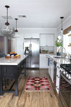 Nona's kitchen: FULL REVEAL. Love everything about this kitchen. Hardware, white cabinets, Valspar's Summer Gray on walls.