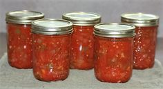 Jars of stewed tomatoes cooling off.
