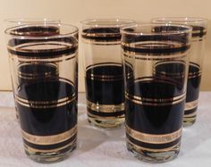 A personal favorite from my Etsy shop https://www.etsy.com/listing/491628677/vintage-barware-black-and-gold-tumblers