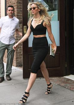 Jennifer Lawrence sizzles in plunging crop top that also shows tummy #dailymail