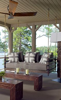 The porch sofa swing... Love Love Love   Love the tables too.  Should be easy to build.