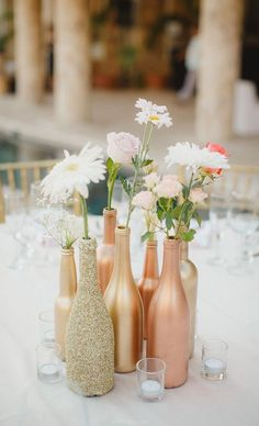 boho glitter bottles and flowers wedding centerpiece / http://www.deerpearlflowers.com/unique-wedding-centerpiece-ideas/2/