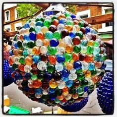 Loads of coloured glass in Golborne Road market earlier today. This one's a light fixture. #latergram