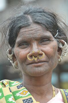 *Kutia Kondh women are marked with geometic facial tattos and traditionally wear a whole row of earring rings, as seen on this lady. Odisha (Orissa), India.