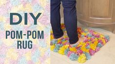 Here's what you'll need! INSTRUCTIONS: DIY Pom-Pom Rug SUPPLIES Yarn Paper Towel roll Scissors Non-Slip Rug Mat INSTRUCTIONS Making The Pom-Poms Cut the pape...