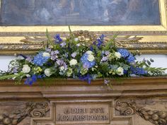 Summer mantel piece of delphiniums, hydrangea, scabious roses, veronica, gladioli, soft ruscus and eucalyptus - Farnham Castle Weddings