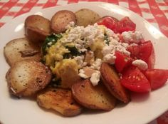 Roasted chicken & baby super greens scramble with feta, tomatoes and home fries.