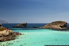 This is Comino, the tiny island off the tip of Italy's boot in the middle of the Mediterranean Sea