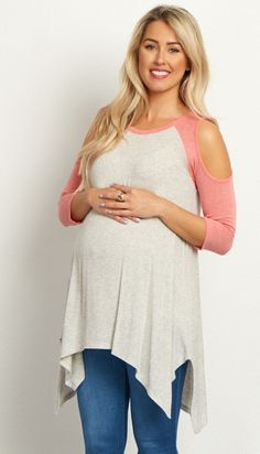 This flowy maternity top is the perfect casual piece to give your wardrobe some flair. A chic colorblock and open shoulder detail keeps you in style, while a flowy asymmetric hem keeps you comfortable. Style with your favorite jeans for a feminine look.