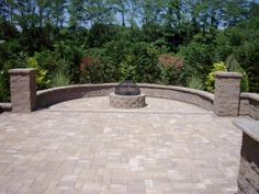 Add a seating wall around your fire pit to create a space for your family to spend time. This backyard was created using pavingstones and a firepit kit by Cambridge Pavers.