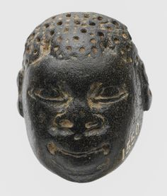 Pendant in the form of the head of an African (known as Ethiopian), 9th–8th century b.c., the Metropolitan Museum of Art  Cypriot; Said to be from Amathus, Cyprus  Chlorite