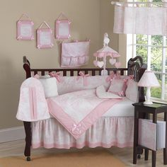 This elegant baby girl crib bedding set uses a traditional French toile print with a super soft chenille and coordinating gingham, decorated in satin bows as a special accent. This collection uses the stylish colors of pink and white.