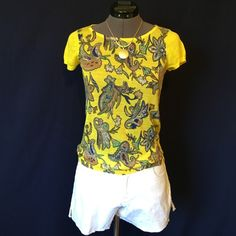 LOFT Knit Tee So Cute!!  Bright yellow thin knit little tee with a beautiful paisley print on the front. 55% Ramie, 45% Rayon, very soft. It is a thin weave so depending on your personal preference you may want to wear a cami underneath. Size XS Petite. Bust measured flat across is 16 inches, back of neck to hem is 20.5 inches. In perfect condition. LOFT Tops Tees - Short Sleeve