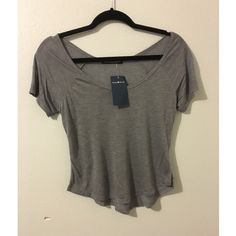 Brandy Melville Gray Top Really cute top. New with tags. Very soft material. Thin material so it can be use to layer. Price is firm unless you bundle. ❌NO TRADES❌ please do not ask Brandy Melville Tops Tees - Short Sleeve