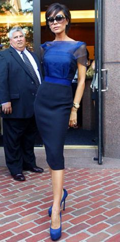 Look of the Day › August 17, 2009 WHAT SHE WORE Victoria Beckham wore a navy and black shift from her own collection with over-size sunglasses, a mens-style gold watch and navy platform pumpsWHERE At the American Idol auditions in Boston