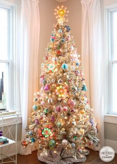 A gold tree decked out in vintage ornaments.