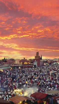 Beautiful skies hang over the busy Jemaa El Fna square in Marrakech, Morocco. Enjoy your holiday in Morocco with theculturetrip.com