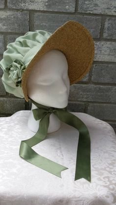 Complete your Regency outfit with this lovely bonnet! This bonnet has a straw brim with a elegant pleated crown. A handmade fabric and ribbon rosette adorns the side of the bonnet. Choose between a narrow brim(green, blue, and pink bonnets pictured) or a wide brim (yellow bonnet pictured). Bonnet Regency Dress, Regency Era, Historical Costume, Historical Clothing, Shrek Costume, Costumes, Costume Ideas, Bonnet Cap, Ribbon Rosettes