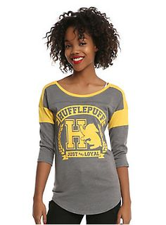 "If the Sorting Hat places you in the Hufflepuff House, it's because you are just and loyal!<br><br>This heather grey athletic style raglan from <i>Harry Potter</i> features a Hufflepuff inspired design with yellow logo graphic on front, yellow details and 3/4 length sleeves.<br><ul><li style=""list-style-position: inside !important; list-style-type: disc !important"">50% cotton; 50% polyester</li><li style=""list-style-position: inside !important; list-style-type: disc !important"">Wash cold…"