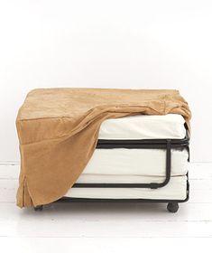 Such a neat idea for kids' sleepovers. Fold-up sleeper Ottoman plowhearth.com $200.00