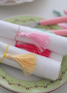 Graduation Party Napkins — I love the tassels wrapped around these silk napkins from CafeNohut. They would look so nice in school colors. They would be really quick to make because those little tassels are readily available – especially this time of year. #graduationparty #napkinideas #diy