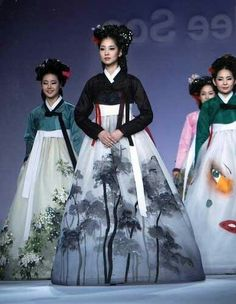 Modern yet traditional Korean dress with beautiful decorated white chima (skirt)