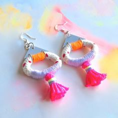 Loop Tassel Earrings made with cotton rope, custom made acrylic triangles, stainless steel jump rings and sterling silver earring hooks.