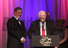 Pete Bradley (left) and co-owner Ron Frankel accept the Eclipse Award for Dayatthespa, Champion Turf Female. photosbyz.com
