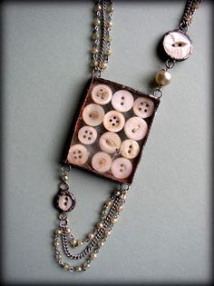Pendant, shadow box of buttons