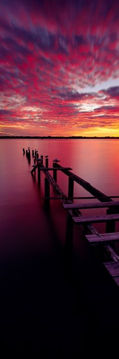 Sunset colours of the rainbow - from pink to blue over the water. Click to discover holiday inspiration from Matthew Williamson. ♠ re-pinned by http://www.waterfront-properties.com/