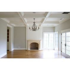 living rooms - gray walls coffered ceiling limestone fireplace French doors decorative wall panels oak wood floors Tiek Built Homes Beautiful, found on polyvore.com.  I want this ceiling!