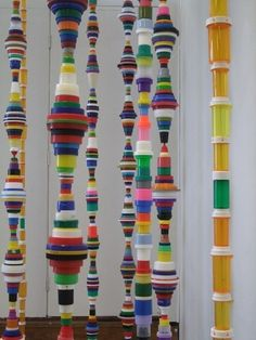 Everyday plastic items, artfully arranged. Installation by Mary Ellen Croteau; we featured her plastic bottle cap portrait earlier on Unconsumption here. See also: Artist Jean Shin's displays of empty pill bottles.
