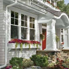 Like style of window boxes. Maybe don't need the corbel below at my house.  Photo: Andrea Rugg | thisoldhouse.com | from Secrets to Great Curb Appeal