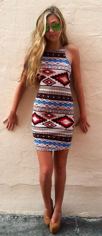 The Mini Tribal Girl Dress. but with a creme colored cardigan