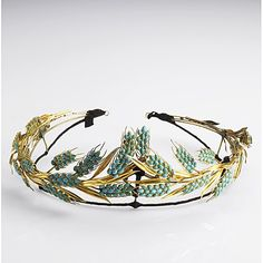 1007: PERSIAN TURQUOISE 18K WHEAT TIARA, 19th C. Neoclassical design on gilt armature. Apparently unmarked. 114 gs. 8 1/3'' x 2 1/2'' Sold at auction 12/2010