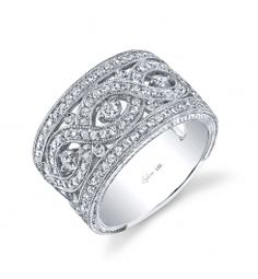 This dazzling 18K white gold diamond fashion ring features 3/4 carats of round brilliant diamonds. (For pricing on this diamond fashion ring and other jewelry, please contact your nearest authorized retailer.)