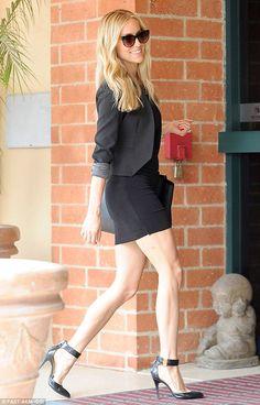 Reality star Kristin Cavallari showed off her long legs in a black mini-dress and sizable heels http://dailym.ai/1u0Skex