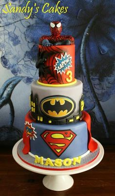 Superhero cake. Awesome birthday party cake with superman, Spiderman and Batman represented in this 3 layered cake masterpiece.