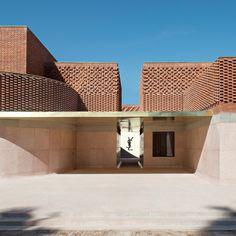 A lace-like brickfacade and an interior inspired by a couture jacket are just some of the fashion-inspired features of Studio KO's Musée Yves Saint Laurent